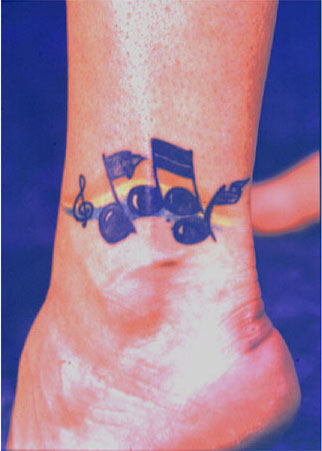 Mike's tattoo, also won her the 1st Place Trophy for Music